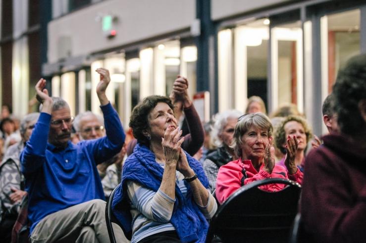 Audience members applaud in response to Sen. Bernie Sanders' remarks. (Photo by Bonnie Chan)