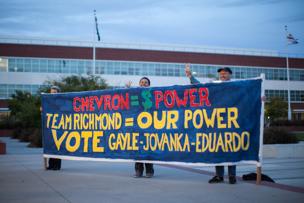 Richmond Progressive Alliance supporters held an anti-Chevron banner outside of the Richmond Memorial Auditorium. (Photo by Martin Totland)