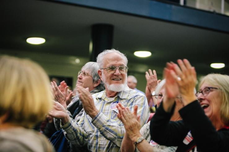 Thad Berkley of Pleasanton, CA, applauds as Senator Bernie Sanders enters the room at the Richmond Memorial Auditorium. (Photo by Bonnie Chan)